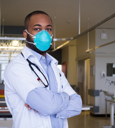 An African doctor wears a mask in a hospital