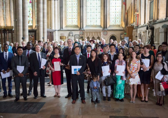 New British citizens gather for a photograph following a British citizenship ceremony