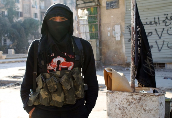 A member of jihadist group Al-Nusra Front stands in a street of the northern Syrian city of Aleppo on January 11, 2014. Fighting pitting ISIS against other rebel groups.