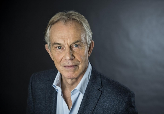 Tony Blair looks to camera