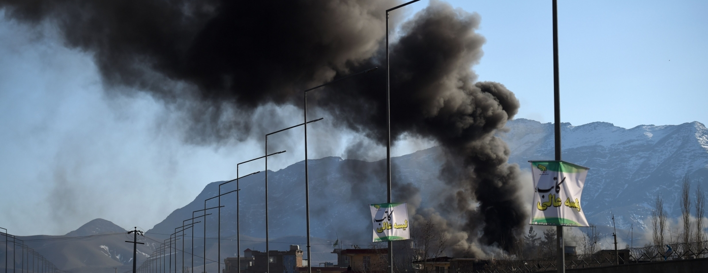 Smoke rises from an Afghan police district headquarters building after a suicide car bomb attack as a gun battle between Taliban and Afghan security forces continues in Kabul on March 1, 2017.