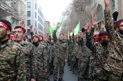 Iranian members of the Basij militia take part in an anti-US rally
