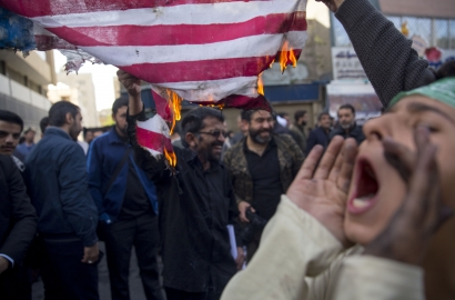 Iranian protesters demonstate outside the former US embassy in the Iranian capital Tehran