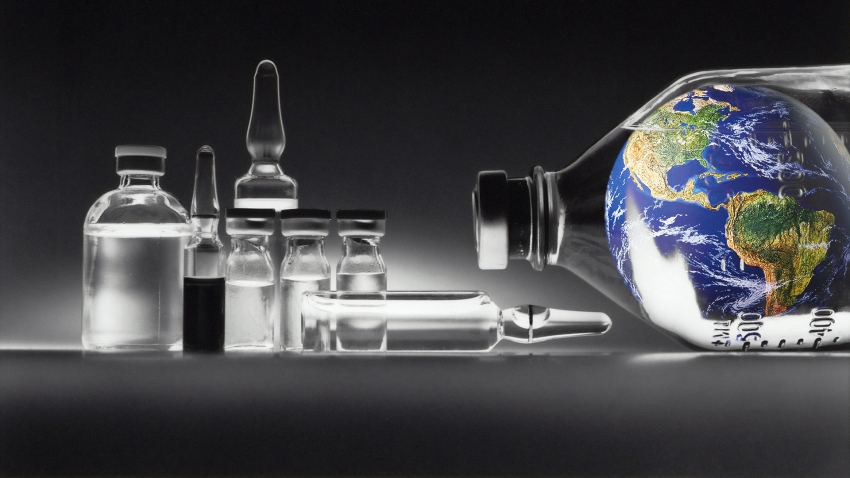 vials of clear liquid and the earth in a vial