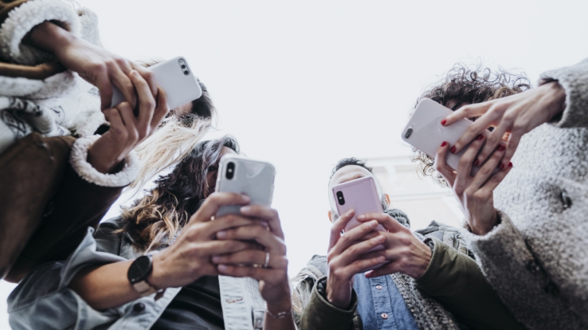 a group of people on mobile phones