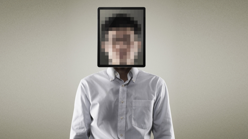a portrait of a person with a pixelated box over their face