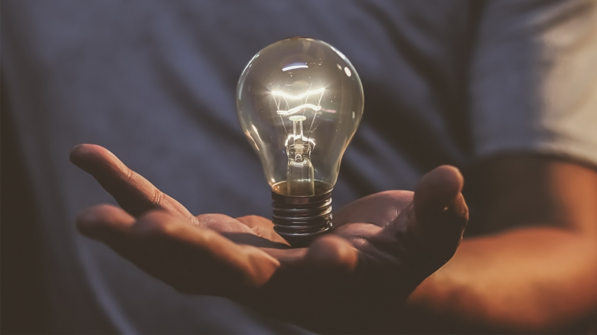 Lightbulb held in hand