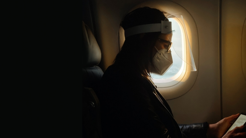 Man sat in plane while wearing mask