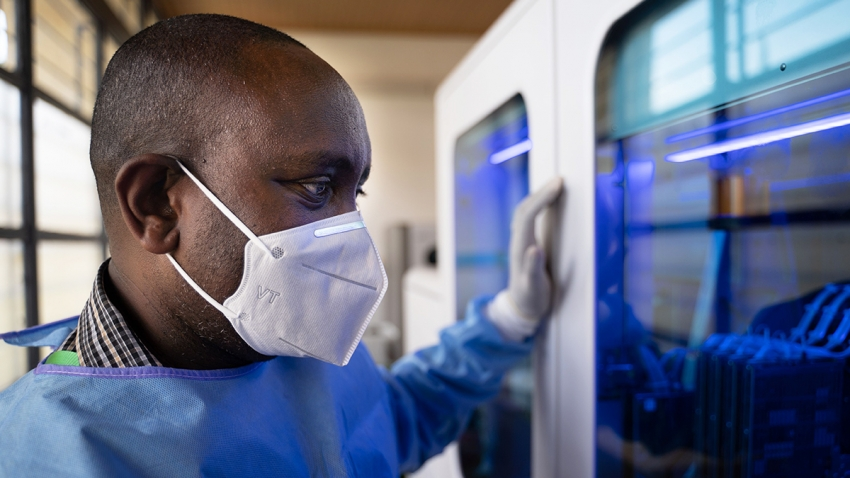 A laboratory technician processes samples for testing the COVID-19, novel coronavirus, at the Rwanda Biomedical Center