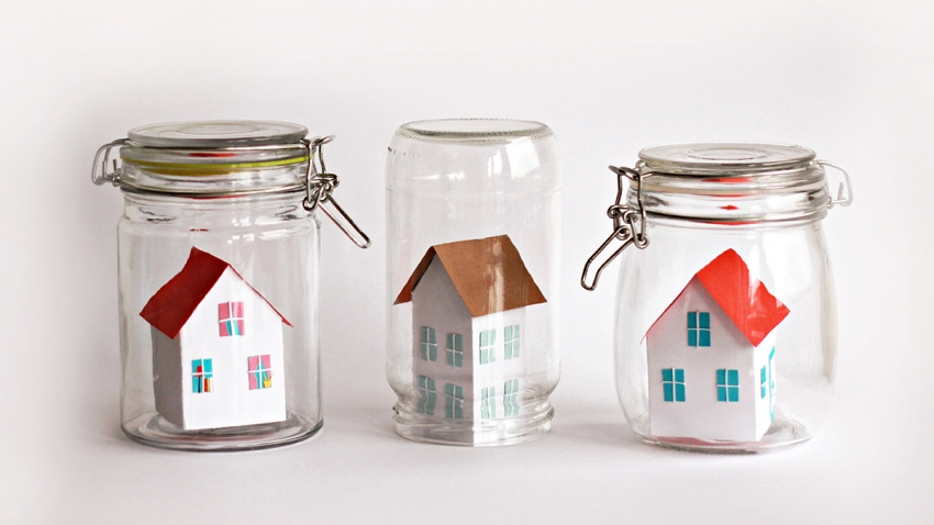 Paper houses sealed inside glass jars