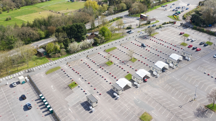 aerial shot of a covid 19 testing centre in a car park in Surrey
