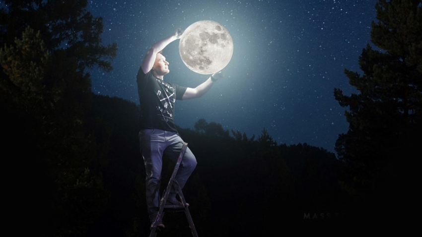 a person holds the moon