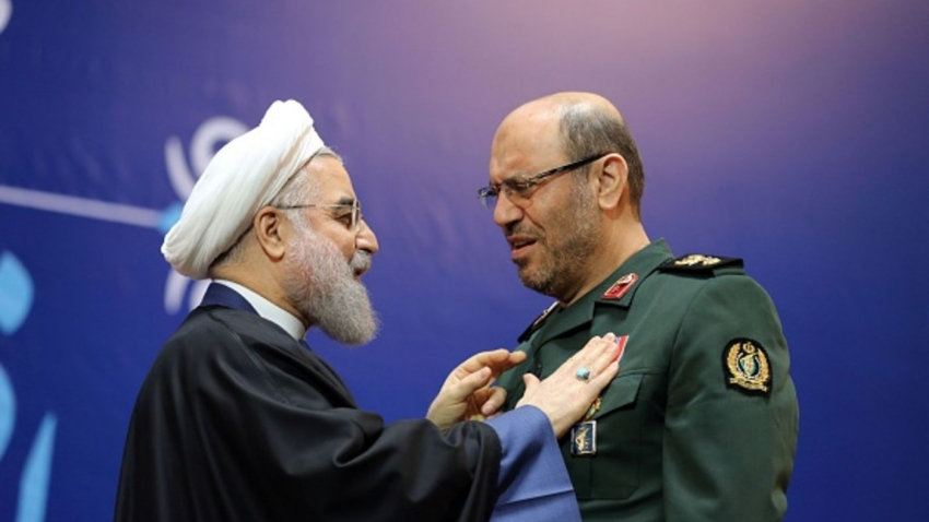 Iranian President Hassan Rouhani (L) awards Iran's Defence Minister Hossein Dehghan with the Medal of Honour for his role in the implementation of a nuclear deal with world powers, on February 8, 2016, in Tehran.