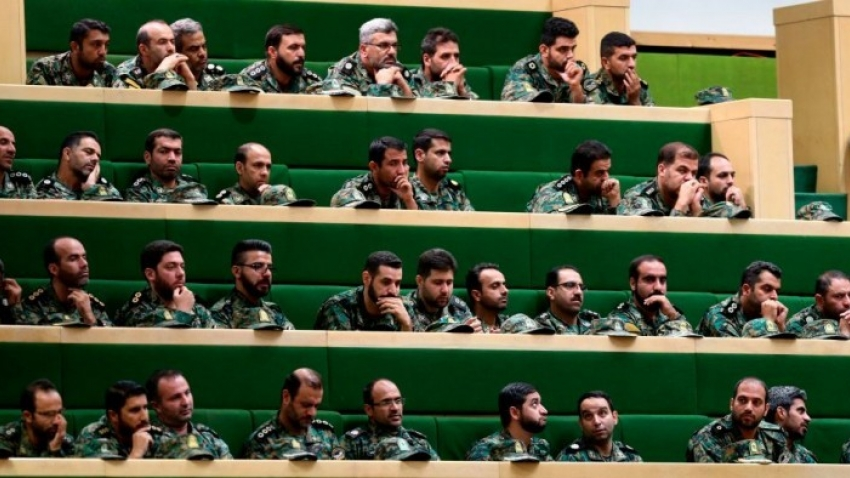 Members of the Iranian Revolutionary Guard listen to a speech in parliament in Tehran on October 7, 2018,