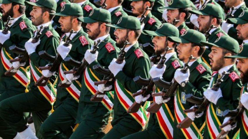 Members of Iran's Revolutionary Guards Corps (IRGC) march during the annual military parade in 2018