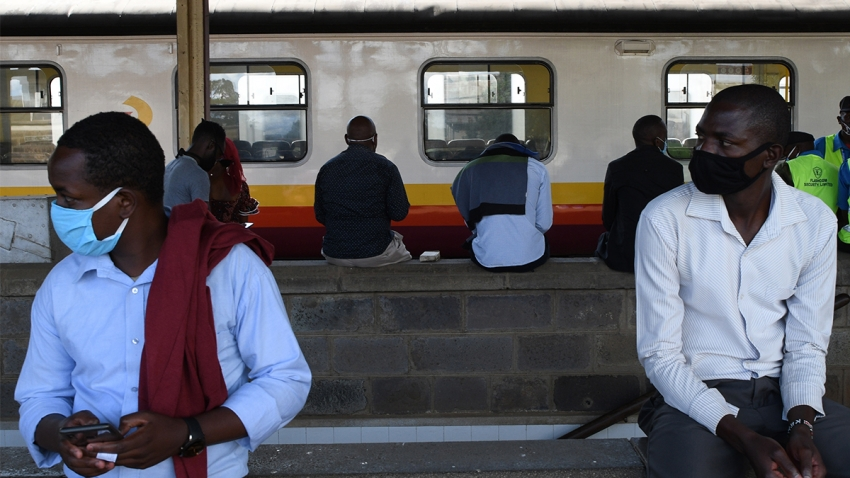 Passengers wait to board the commuter train service at the main railway station before th curfew, as a measure to contain the spread of the COVID-19 coronavirus, in Nairobi, May 4, 2020