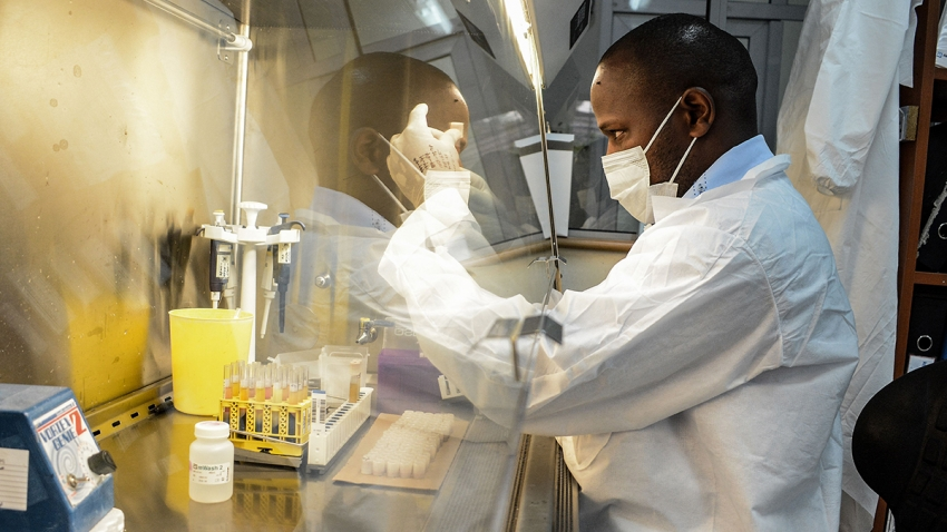 A researcher prepares reagents for testing the samples for the COVID-19 coronavirus at the laboratory of Kenya Medical Research Institute