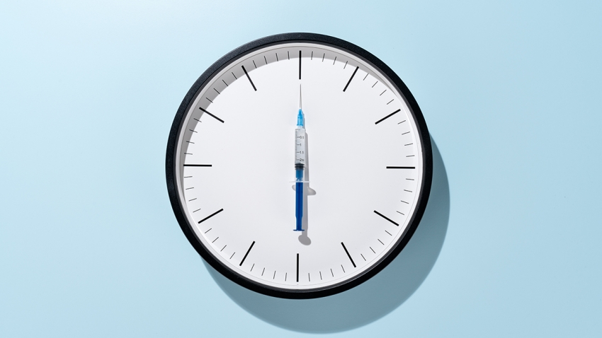 Twelve hour clock overlayed with a syringe