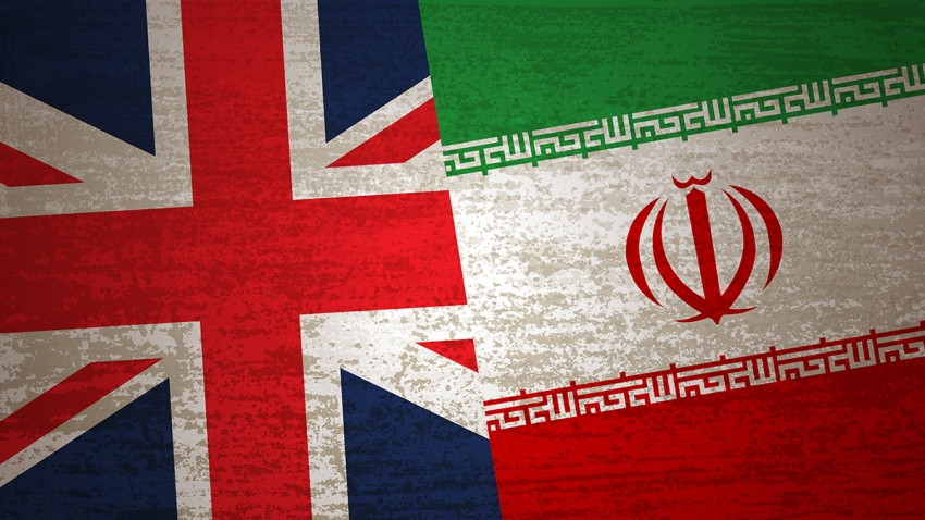 photo illustration of british and iranian flags