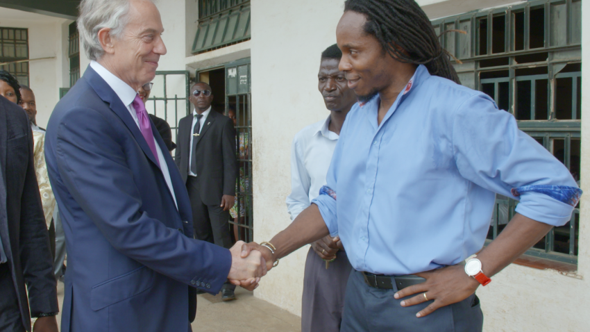 Tony Blair shakes hands with Dr David Sengeh