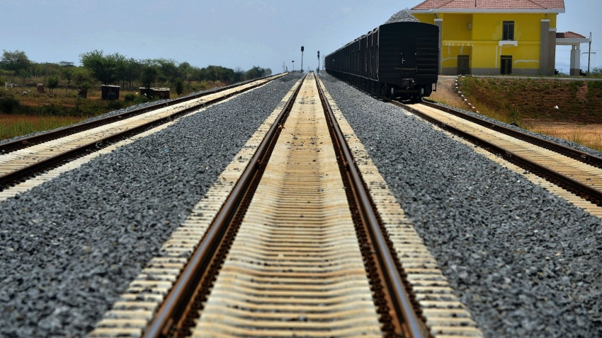 Cargo cars carrying ballast stands on the tracks of a section of the new Standard Gauge Railway.