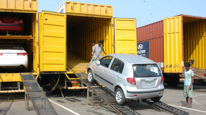 A car being loaded in a shipping container in Tamil Nadu