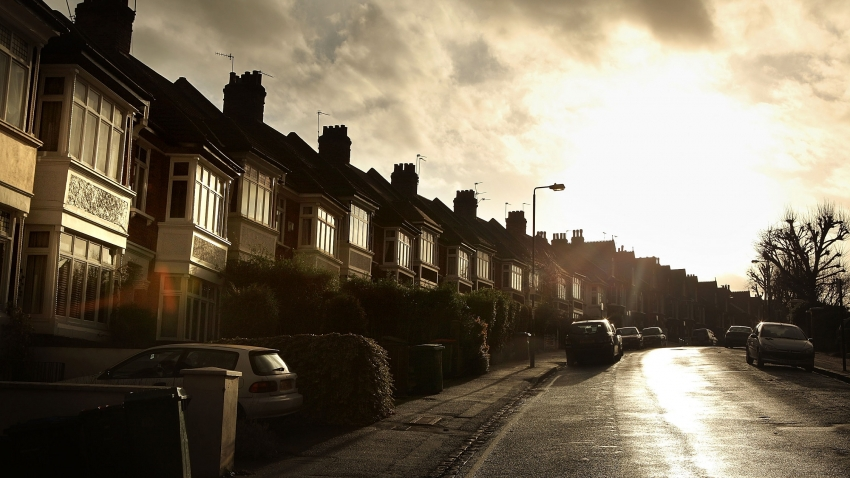 A street of houses in the sun.